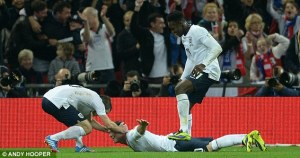Rooney celebrates by mimicking Wellbeck's surfboard as team mates take it in turns to drag him around the pitch by the head for most of the second half.